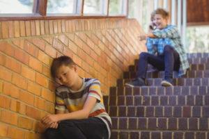 school-friend-bullying-sad-boy-school-corridor_107420-85198
